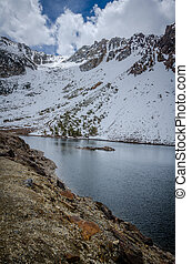 Tenaya Lake with snow on the mountains in early spring This alpine lake is in Yosemite National Park, along Tioga Pass in California