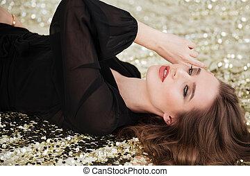 Tender beautiful young woman in black dress
