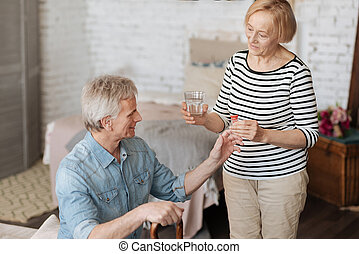 Tender bright lady assisting her husband