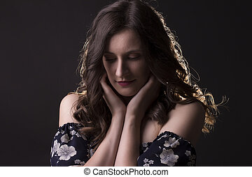 Tender brunette woman in the shadows