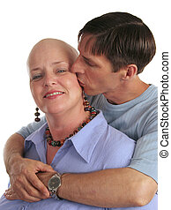 A woman undergoing chemotherapy and her supportive, loving husband.