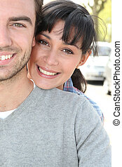 tender couple hugging in the street