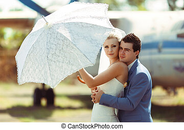 Tender embracement of the couple in the wedding day