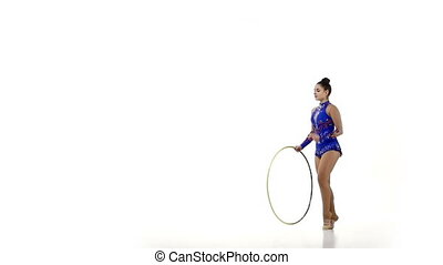 Tender  gymnast  dance with hula hoop, slow motion