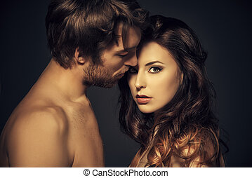 tender kiss - Beautiful passionate naked couple in love....