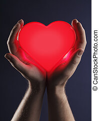 Man holding a red glowing heart in his hands.