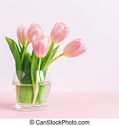 Tender pink tulips in a vase. Greeting card for Mother's day.