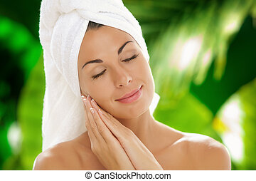 tender - portrait of young beautiful woman in spa...
