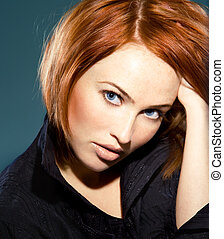 close up portrait of young beautiful red haired woman