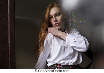 Tender redhead model with freckles in white shirt
