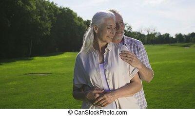 Tender romantic moment of retired senior couple