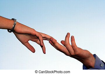 Tender touch - A man's hand and woman's hand touching each...