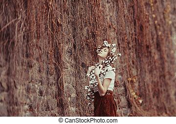 Tender woman enjoing nature. Boho style fashion.