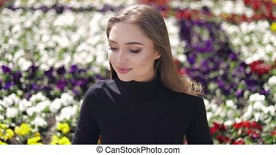 Tender woman on background of flowers - Young woman with...