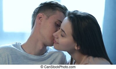 Tender young couple in affectionate sensual kiss - Portrait...