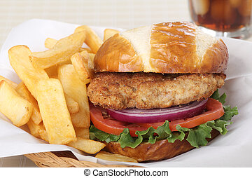 Pork tenderloin sandwich with french fries in a basket