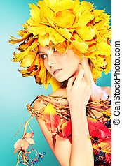 tenderness - Beautiful autumn girl in a hat of maple leaves.