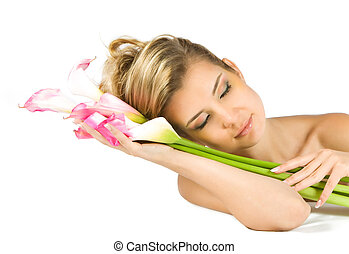 Blonde lady dreaming with gladious flowers in her hands