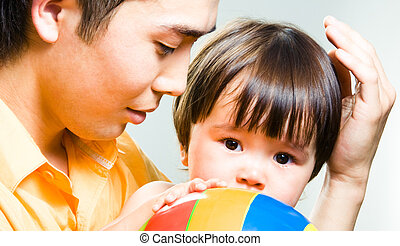 Tenderness - Close-up of loving father touching gently his ...