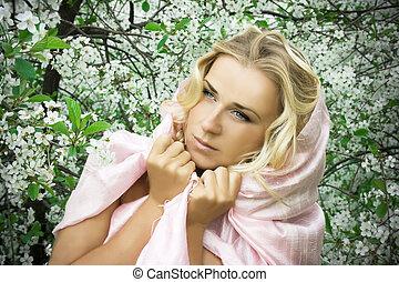 Tenderness - Girl in rose tippet in spring time garden