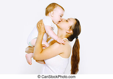 Tenderness, happy mother kiss baby