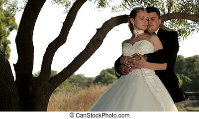 Tenderness - Husband tenderly embracing his wife.