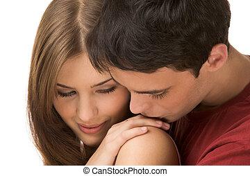 Image of tender man kissing girl?s hand on her shoulder