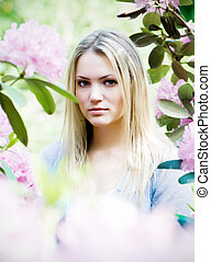Tenderness of summer - Beautiful young woman in blooming...