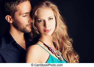tenderness - Portrait of a beautiful young couple in love ...