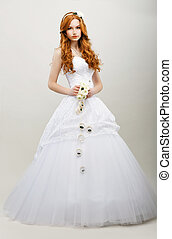 Tenderness. Redhaired Exquisite Bride in White Bridal Dress....
