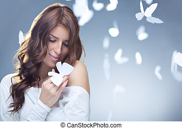 Tenderness - Smiling girl with butterflies in studio