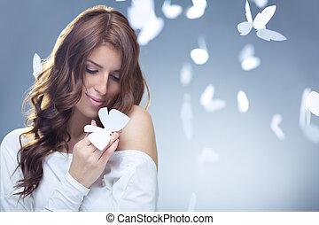 Tenderness - Smiling girl with butterflies in studio