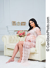 Tenderness waiting child. Expectant mother looking at pregnant belly