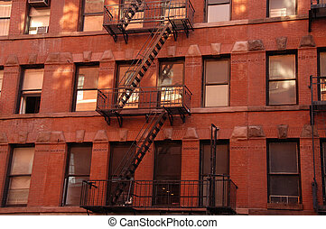 Tenement buildings in New York City, with fire escape