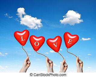 tenencia de la mano, un, corazón rojo, balloons.