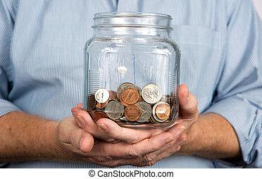 tenencia, un, tarro, de, coins, dinero