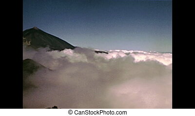 fog on the top peak of the Teide Volcano mountain in Teide National Park. Historical archival of Tenerife island of Spain in Africa in 1970s