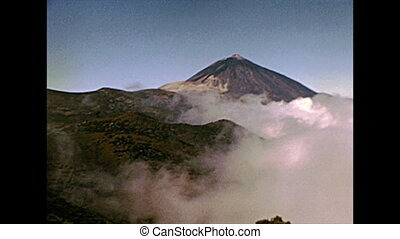 peak with fog of the Teide Volcano mountain in Teide National Park. Historical archival of Tenerife island of Spain in Africa in 1970s