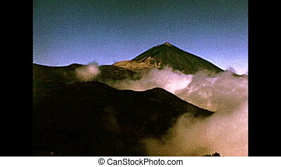 peak of the Teide Volcano in the fog from the Teide National Park. Historical archival of Tenerife island of Spain in Africa in 1970s