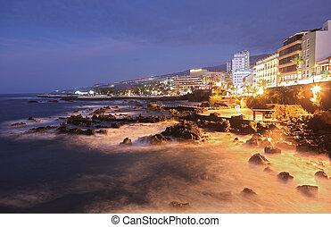 Tenerife - Puerto de la Cruz. Long exposure night scene showing the waterfront.