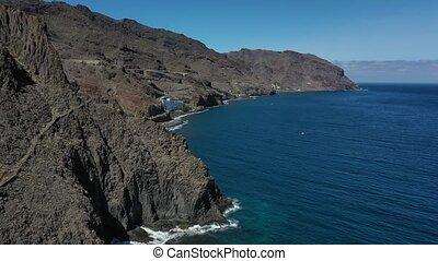 Tenerife, rocks, cliff, waves of the Atlantic ocean. - ...