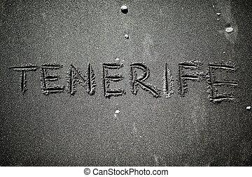 tenerife text title on volcanic beach black sand