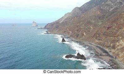 Tenerife, the wild Benijo beach with black volcanic sand. ...