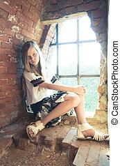 Tennage girl  inside ruins