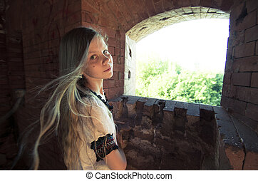 Tennage girl  inside ruins
