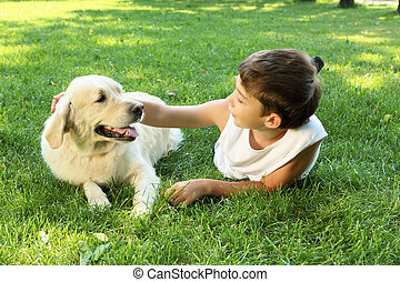Tennager boy in the park with a dog