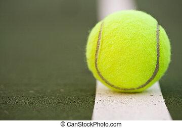 Tennis ball - A closeup shot of a tennis ball in a tennis...