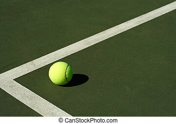 Tennis ball - A tennis ball in a tennis court