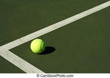 Tennis ball - A tennis ball in a tennis court