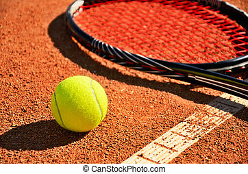 tennis ball and racket is on the carpet court closeup